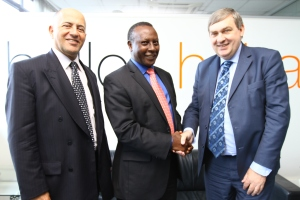 """Change of Guard: Board Chair of Orange Telkom Kenya, Eddy Njoroge (centre) congratulates Vincent Lobry (right), the new Chief Executive Officer of the company, upon his appointment which takes effect September 4, 2014. Mickael Ghossein, the immediate former Chief Executive of Telkom Kenya (left) becomes Senior Vice President of Orange Business Services – Middle East."